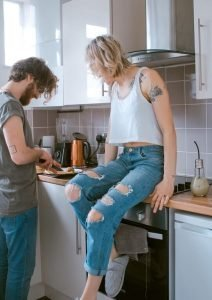 Couple cooking together in the kitchen for date night